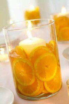 decorar con velas y naranjas